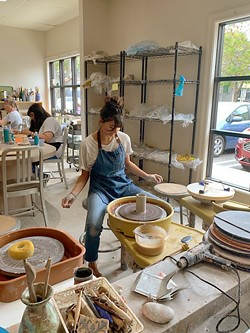 IN THE WORKS A potter spins up something new on a wheel at Anam Cre' Studio. - PHOTO COURTESY OF SHEVON SULLIVAN