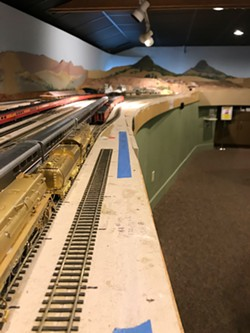 MODEL A model railway sits in the SLO Railroad Museum. Pictured is the train station in SLO—note Bishop Peak and Cerro San Luis in the background. - PHOTOS BY PETER JOHNSON