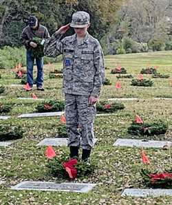 APPRECIATION During a Dec. 14 ceremony, Coni Wells watched her 13-year-old son Colton place wreaths on graves and salute veterans who were laid to rest in the Paso Robles District Cemetery. - PHOTO COURTESY OF CONI WELLS
