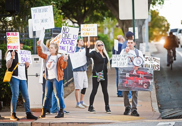 """JUSTICE FOR BUBS Demonstrators protesting the SLO Police Department stand at the corner of Santa Rosa and Monterey streets on Jan. 14. They chanted, """"SLOPD we want the body cam! SLOPD is not above the law!"""" - PHOTO BY JAYSON MELLOM"""