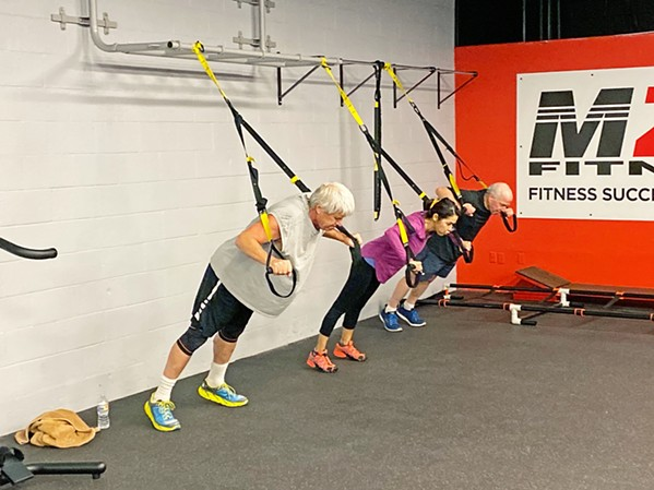 A PERSONALIZED WORKOUT MZR Fitness clients have access to personal and group training and a number of classes and programs. - PHOTO COURTESY OF MIKE ROBINSON
