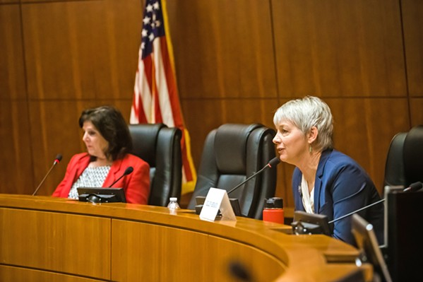DEBATING Ellen Beraud (right) talks during an election forum against Debbie Arnold, SLO County's 5th District supervisor. - PHOTO BY JAYSON MELLOM