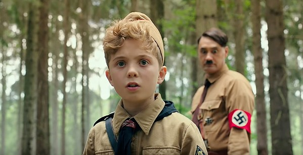 IMAGINARY FRIEND Nazi Youth member Jojo (Roman Griffin Davis, foreground) navigates the moral quandaries of Nazism with help of his imaginary friend, Adolf (Taika Waititi), in the Oscar-nominated satire, Jojo Rabbit, back in theaters. - PHOTO COURTESY OF FOX SEARCHLIGHT PICTURES