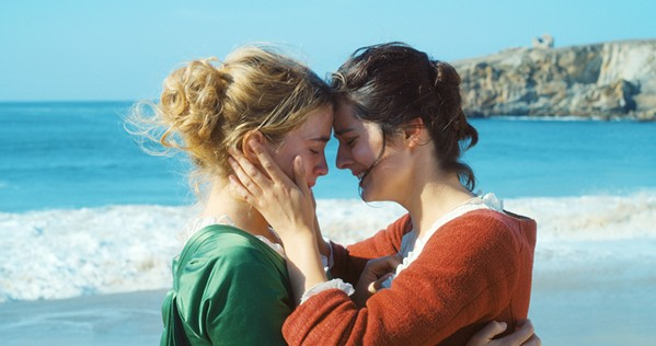 HIDDEN LOVE Marianne (Noémie Merlant, right) is commissioned to paint Héloïse's (Adele Haenel) wedding portrait without her knowing, which is complicated as the women become closer, in Portrait of a Lady on Fire. - PHOTO COURTESY OF ARTE FRANCE CINEMA