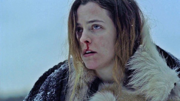 BUMPS IN THE NIGHT Trapped in a snowed-in lodge with two children, Grace (Riley Keough) experiences weird stuff that threatens to conjure psychological demons from her past, in The Lodge. - PHOTO COURTESY OF HAMMER FILMS