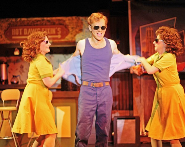 "BENEATH THE SURFACE Double Cupp Diner runners Prudie and Rhetta Cupp (Katie Worley-Beck, left, and Eleise Moore, right, respectively) help gas station attendant L.M. (Mark Schenfisch) let loose during the musical number, ""Farmer Tan."" - PHOTOS COURTESY OF DAN SCHULTZ"
