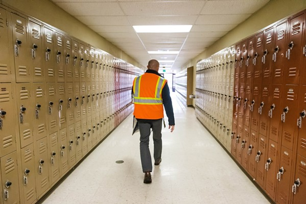 SURVIVAL INSTINCTS SLO High School Principal Leslie O'Connor walks the halls during a lockdown drill in January 2019. On Feb. 28 of this year, a scheduled earthquake drill at SLO High accidentally turned into a lockdown that students thought was real. - FILE PHOTO BY JAYSON MELLOM