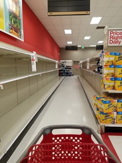SOLD OUT Emergency supplies like toilet paper are stripped off many local store shelves, like Target's in San Luis Obispo, as locals prepare for the novel coronavirus. - PHOTO BY ANDREA ROOKS