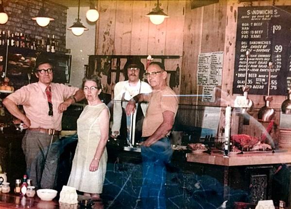 OPENED 1971 Stan Van Beurden opened Hofbrau der Albatross in 1971. Pictured is his dad, Cornelius (far left), his brother Joost (back) with two of the Morro Bay restaurant's first customers. - PHOTO COURTESY OF STAN VAN BEURDEN