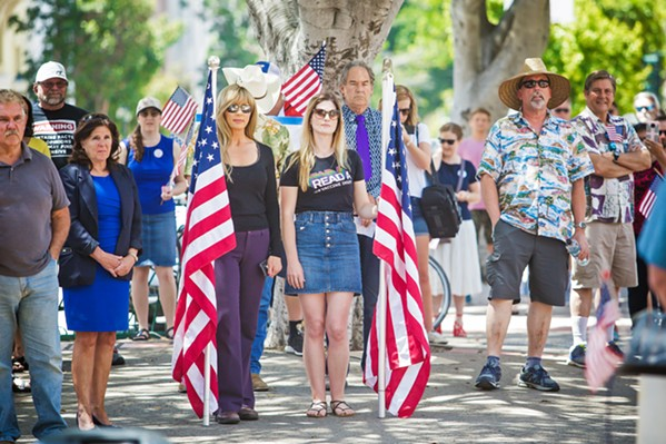 """FREEDOM FIGHTERS SLO County 5th District Supervisor Debbie Arnold (left) said that residents who attended the ReOpen SLO County rally were concerned that their """"constitutional freedoms are being assaulted."""" - PHOTOS BY JAYSON MELLOM"""