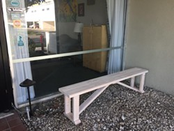 OUTBREAK Amid the COVID-19 pandemic, Country Oaks Care Center restricted visits and set up a bench outside its lobby windows so family members could see their relatives while talking with them on the phone. But a recent COVID-19 outbreak at the nursing facility has led to five deaths so far. - PHOTO COURTESY OF COUNTRY OAKS CARE FACILITY