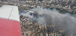 RIVER BLAZE A 15-acre fire on June 22 jumped the Salinas River and burned down two homes. - PHOTO COURTESY OF FIVE CITIES FIRE AUTHORITY