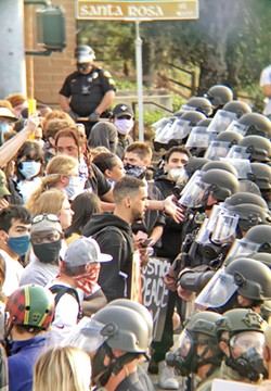 AFTER ACTION The SLO Police Department is preparing a report following recent protests, including the June 1 protest that ended in police using tear gas. - FILE PHOTO BY PETER JOHNSON