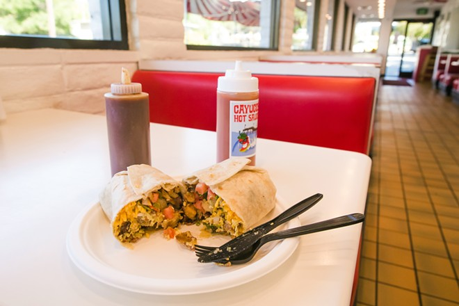 POUND IT Every year, almost without fail, Frank's Famous Hot Dogs in SLO takes home the Best Hangover Food and Best Breakfast Burrito awards. - PHOTO BY JAYSON MELLOM