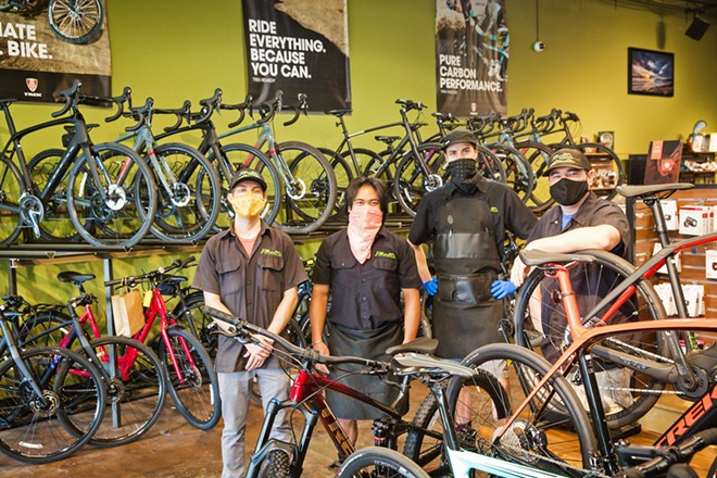 BUY THAT BIKE Left to right: Brad Wiggs, Dustin Stiffler, Adam Jacino, and Josh Cohen at Foothill Cyclery in SLO are ready to outfit you with new gear and help you troubleshoot your bike problems from a safe distance. - PHOTO BY JAYSON MELLOM