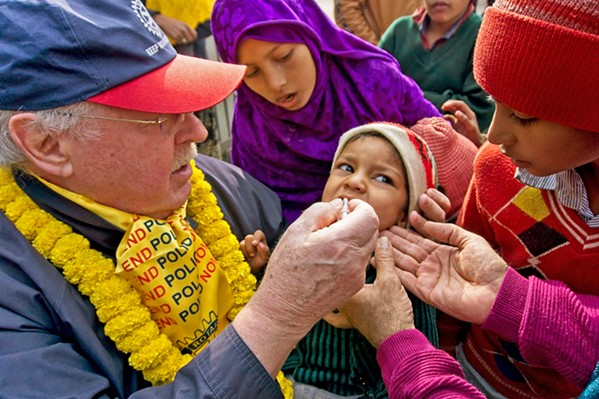 LIFE SAVER An American Rotarian delivers two oral drops of polio vaccine to an Indian child in local filmmakers Eriksen and Soren Dickens' documentary, Two Magic Drops, available for free on YouTube. - PHOTOS COURTESY OF LAURIE EDWARDS