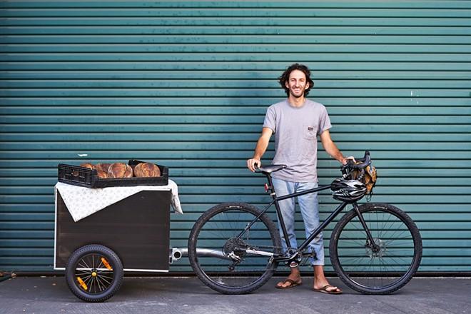 PURE, LOCAL GOODNESS Sam DeNicola, co-owner of Bread Bike, takes pride in providing naturally leavened, 100 percent organic California-grown grain breads.