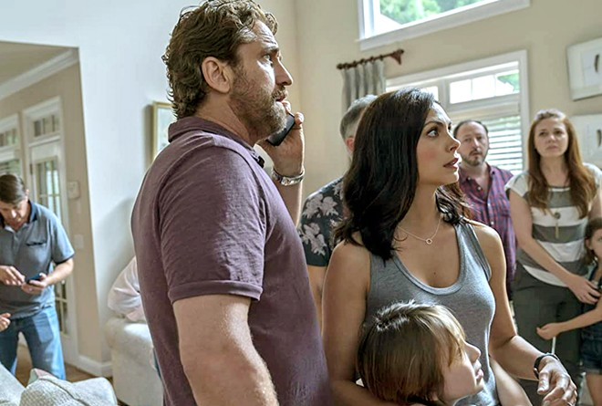 READY TO RUN! The Garritys—(center) John (Gerard Butler), Allison (Morena Baccarin), and their young son Nathan (Roger Dale Floyd)—learn they've been chosen to join a group of selected survivors being transported to underground bunkers, in Greenland, available at Redbox.