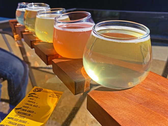 CATCH A FLIGHT SLO Cider Co. has several different apple ciders on tap, including (front to back) pineapple, blood orange, lemon ginger, hopped, and dry.