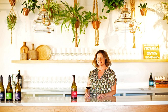 RAISING THE BAR While the Story of Soil tasting room is located in Los Olivos, owner and winemaker Jessica Gasca (pictured) collaborates with vineyards all over Santa Barbara County to create her varietals, including Duvarita Vineyard in Lompoc, Larner Vineyard in Ballard, and Gold Coast Vineyard in Santa Maria.