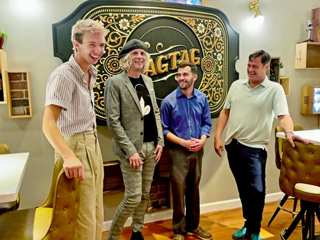 INVITING VIBE From left, servers Luke O'Leary, Ryan Moreira, and Thomas Grandoli, and tasting room manager Patrick McTiernan greet customers at Ragtag's recently opened tasting room in downtown San Luis Obispo.