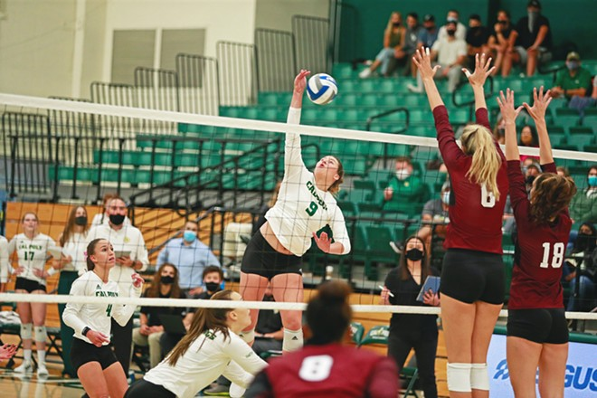 HOMECOMING After more than 600 days away, the Mustangs' volleyball team returned to the Mott Athletics Center court in 2021.