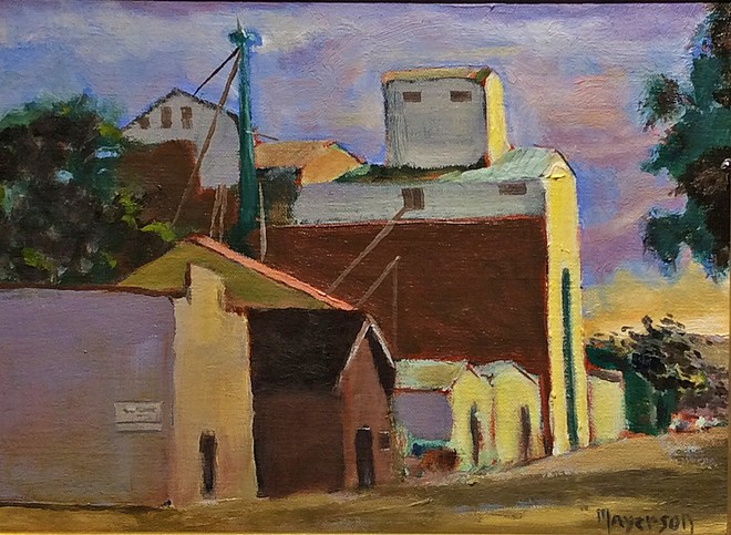 BETWEEN THE SHADOWS Drew Mayerson's painting style illuminates the iconic Templeton Feed & Grain building.