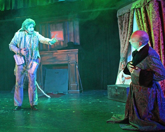 LIFE CHAIN-GING After a chilling encounter with the ghost of his deceased colleague, Jacob Marley (Jeff Salsbury, left), Ebenezer Scrooge (Billy Breed, right) is visited by three spirits, in A Christmas Carol.