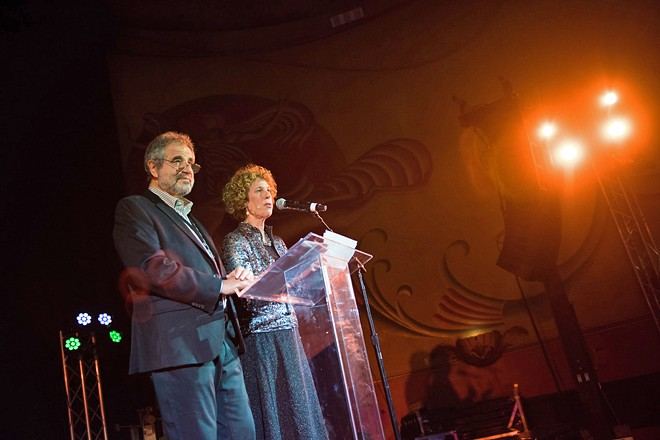 WHEN PROXIMITY WAS ALLOWED SLO Film Fest Director Wendy Eidson (right) shares the 2019 opening night stage with local attorney and festival executive board President Paul Metchik in the time before COVID-19.