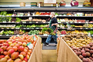 COMMUNITY-OWNED Kit Sanders strolls through the produce section at the Best Natural Food Store around, the SLO Food Co-op, where you can find organic local produce; grab 'n' go meals; herbs; bulk grains, nuts, and treats; organic natural meats; and more. - PHOTO BY JAYSON MELLOM