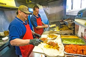 BURRITOS UP (Left to right) Jesus Rivera and Carlos Cortes bust out the best BREAKFAST burritos in the county at Frank's Famous Hot Dogs. Don't forget, the dogs are good, too. - PHOTO BY JAYSON MELLOM