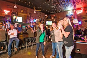 GRAB THE MIC  (Left to right) Marcy Maretti, Megan Brewer, Jenny Taylor, and Lynda Basil belt it out during karaoke at Bill's Place. - PHOTO BY JAYSON MELLOM