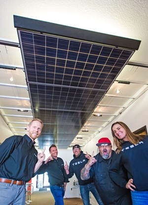 DOUBLE TAKE Yes, everyone, TESLA is now in the SolarCity business. From left to right: Tyson Maulhardt, Chris Bechtel, William Townsley, Dog, and Gina Armstrong are all pretty happy to work at the best solar company in the county. - PHOTO BY JAYSON MELLOM
