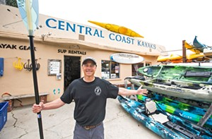 PEOPLE POWER Central Coast Kayaks co-owner Tom Reilly knows that some of the coolest places on the coastline are only accessible by kayak or paddleboard. Maybe that's why he's co-running the best water sports company in the county! - PHOTO BY JAYSON MELLOM