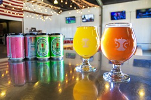 APPLES ON POINT Tin City Cider takes home the Best Cider award this year. Belly up to the bar for a glass of Bunny Lebowski (above, left), cider fermented with blonde ale wort and wild yeast, or grab a can of Polly Dolly (above, right), a blend of cider, rosé, and citra hops, off the shelf. - PHOTO BY JAYSON MELLOM