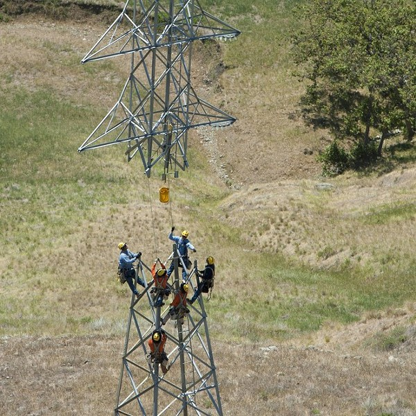 OUT OF POWER PG&E crews work on a power line tower in SLO County. SLO County could be hit with rotating power outages in the coming days. - FILE PHOTO BY STEVE E. MILLER