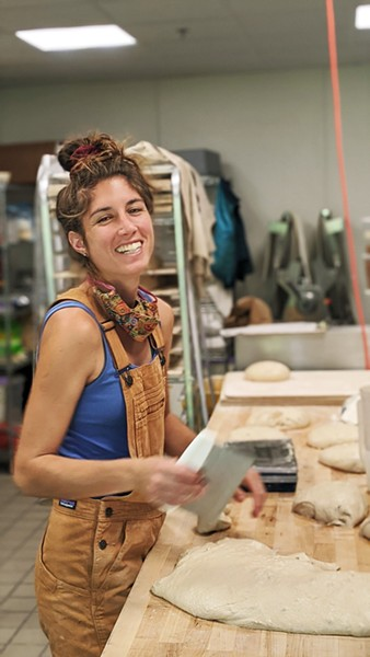 BREAD MAGIC Mariah Grady, co-owner of Bread Bike (seen here before she shaved her head), is all about creating magic. The SLO native never tires of baking (and sampling) every loaf that comes out of the oven. - PHOTOS COURTESY OF PRESTON RICHARDSON