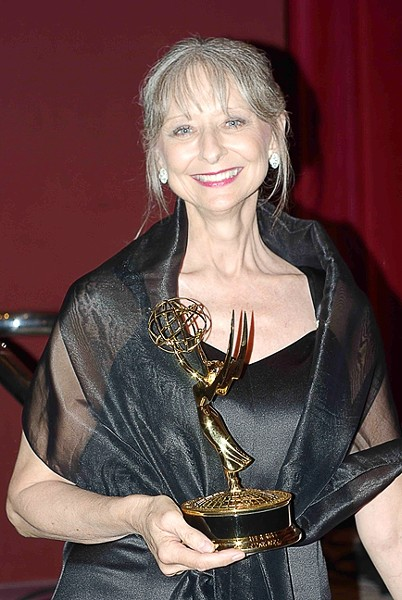 ACTOR EXTRAORDINAIRE :  Rae Stone—an actor, teacher, and supporter of theater on the Central Coast—died of cancer Friday, Aug. 24, while staying with her mother in Florida. Locals, however, are only recently learning of her passing. Pictured is Stone in 2006 with the Emmy she won for her on-air work on a PSA. - PHOTO BY SHAMA RAJ