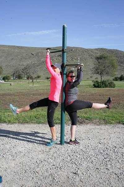 LEGS LIFTS?:  UGH! Kristen Meisenheimer (left) and Anna Starkey feel the burn. - PHOTO BY GLEN STARKEY