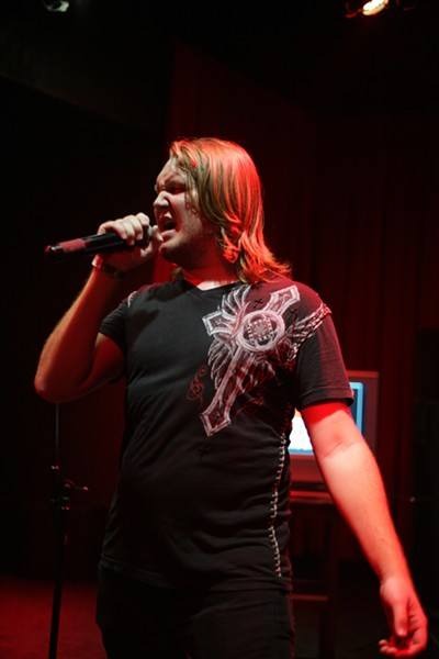 """THE BIG WINNER!:  The $500 went to grand champ Jeff Mitchell, who finished the evening by performing Guns N' Roses' """"Paradise City."""" - PHOTO BY ANNA STARKEY"""
