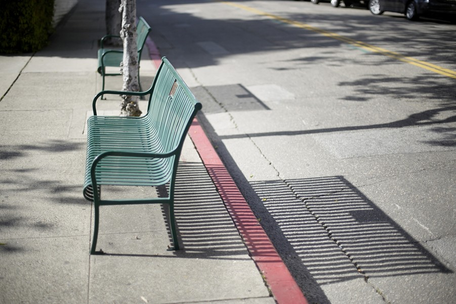 BENCHES? WE DON'T NEED NO STINKING BENCHES:  According to SOFCO, removing these green park benches will help eliminate panhandling downtown. - PHOTO BY GLEN STARKEY