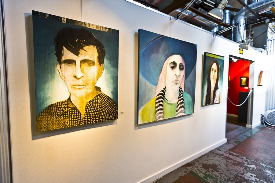 DHARMA BUM:  Tom Peck layers paint and newsprint in his portrait series featuring two paintings of novelist Jack Kerouac. - PHOTO BY KAORI FUNAHASHI