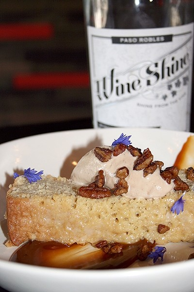 HAVE YOUR CAKE:  Chef Mateo Roger's take on tres leches is a little more boozy than average. The Hooch Cake is made with local Wine Shine, burnt caramel, and house-made buttered pecan ice cream. - PHOTO BY HAYLEY THOMAS