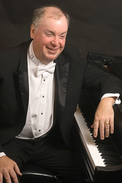 MAGIC FINGERS :  Cal Poly Music Department Chair and pianist extraordinaire W. Terrence Spiller will deliver an evening of Mozart, Ravel, Bartok, and Liszt on Jan. 9, in the Spanos Theatre at Cal Poly. - PHOTO COURTESY OF CAL POLY MUSIC DEPARTMENT