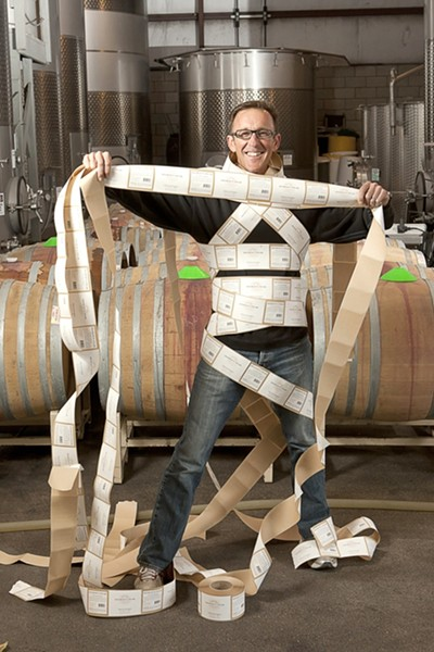 WRAPPED UP IN HIS WORK :  Brian Talley is proud to put his vineyards' name on the Bishop's Peak label. He's also excited to be working with the new team of assistant winemaker Eric Johnson and winemaking consultant Byron Kosuge. - PHOTO BY STEVE E. MILLER
