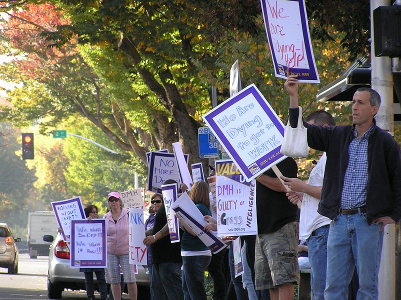 HAD ENOUGH :  Dozens of employees from Napa State Hospital protested in front of the state Department of Mental Health headquarters after Donna Gross, 54 of Concord, was murdered, allegedly by a patient. - PHOTO BY COLIN RIGLEY