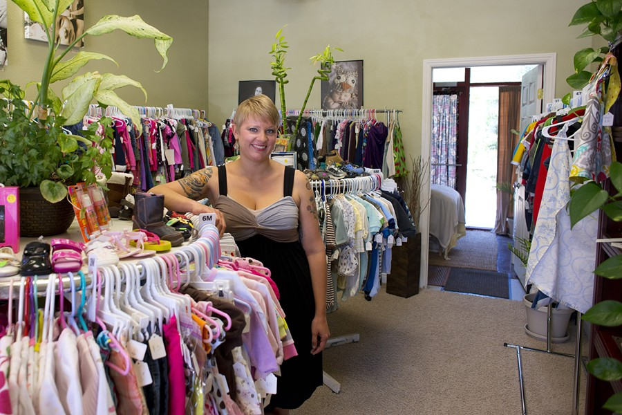 MOTHERS ONLY? :  Tina Risley, owner of Barefoot MomEase Wellness Spa, offers massage and wellness education, as well as a wide selection of gently used children's clothing at low prices. - PHOTO BY STEVE E. MILLER