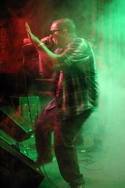 BEST HIP-HOP:  Roach Clip of Famous Deuce & Roach Clip emerges from the fog during their rousing opening set. - PHOTO BY GLEN STARKEY