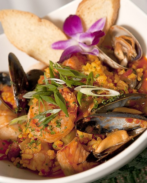 TRY IT :  Chef Everett Walcott's signature dish, The Sea Venture, includes paella and cioppino. - PHOTO BY STEVE E. MILLER