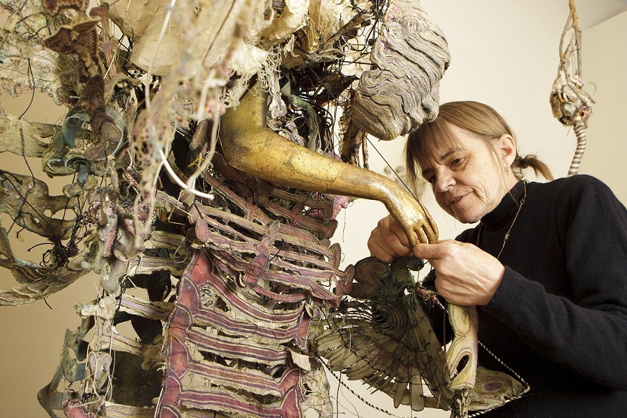 "FINAL TOUCHES :  Pictured is Higby hard at work before the opening of her exhibit ""Noh Works."" Her sculptural costumes, made of wood, silk, gold leaf, ceramic, lacquer, fabric, and paper, can take years to complete. - PHOTOS BY STEVE E. MILLER"